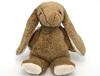 Lapin en coton bio beige avec de longues oreilles et la plante des pattes  en mohair blanc, assis.