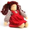 Doll in organic wool and cotton with blue eyes and  dark brown woolen hair. She is sitting and wears a striped sweat shirt and a red velvet gown.