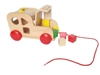 Wooden pull along taxi with open hood and in the walls holes with different shapes. Inside the hood and in front of the wooden car are several little wooden blocks with different colors and different shapes.
