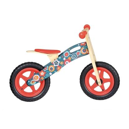 Houten loopfiets met 2 rode kunstoffen wielen, rode zadel, rode handvaten en bloemetjes.